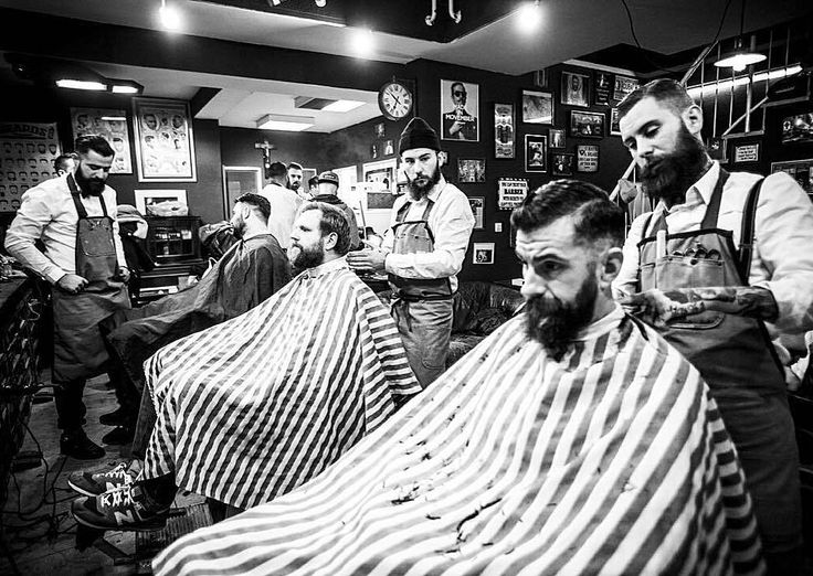 """MEET YOUR LOCAL BARBER - @torreto_barbershop  The rules for customers are clear. One: """"No girls."""" And two: """"What happens in the #barbershop stays in the barbershop."""" In fact #smoking #whisky and #beer are allowed and even welcome in Torreto Barbershop and customers have a #drink or #smoke while they get their hair cut or their #beards trimmed.  Stay handsome. -  @sreckomi for @torreto_barbershop  #barber #oakbeardcare #meetyourlocalbarber #ffm by oakbeardcare"""