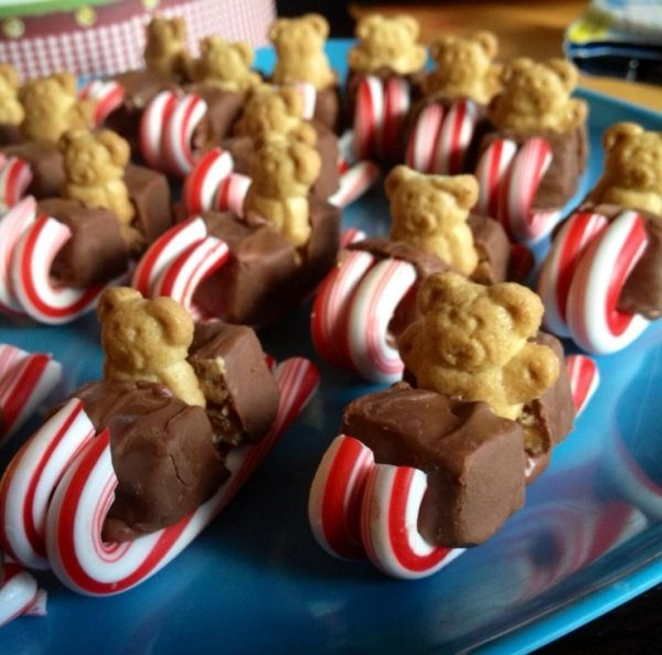 Teddy grahams in a sled made of a mini candy bar and two mini candy canes by millicent