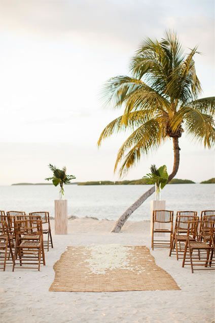 Beautiful and simplistic beach wedding ceremony | Photo by KT Merry