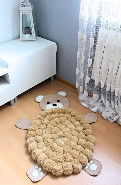 Pom Pom Rug | Rugs are essential in your kid bedroom or play room. They keep them safe and comfy.  http://www.contemporaryrugs.eu/