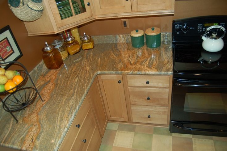1000+ images about granite on Pinterest | Grey cabinets ... on Natural Maple Cabinets With Black Granite Countertops  id=91853