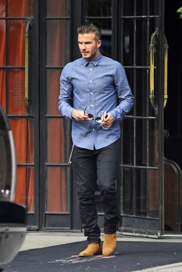 Shop this look on Lookastic:  https://lookastic.com/men/looks/blue-chambray-long-sleeve-shirt-black-chinos-tan-suede-chelsea-boots/14354  — Blue Polka Dot Chambray Long Sleeve Shirt  — Black Chinos  — Tan Suede Chelsea Boots