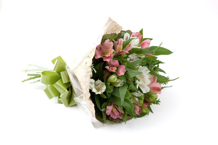 Posy of alstromeria flowers with a lotus leaf wrap.