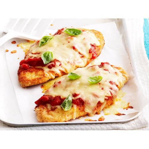 Easy chicken parmigiana recipe - By Woman's Day, Spruce up your humble chicken schnitzel with the addition of tomato pasta sauce, melted cheese and fresh basil. This simple topping adds a world of flavour that will delight your friends and family.