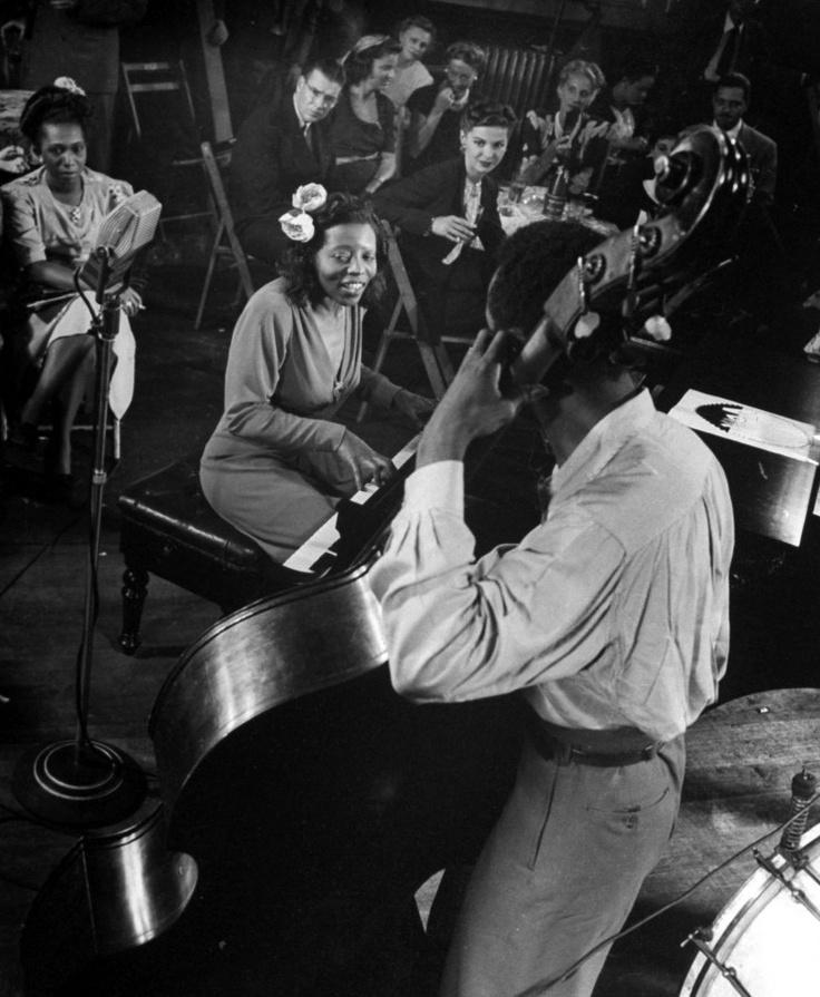 Mary Lou Williams (who arranged for Ellington's band) jams in Gjon Mili's studio, New York, 1943.