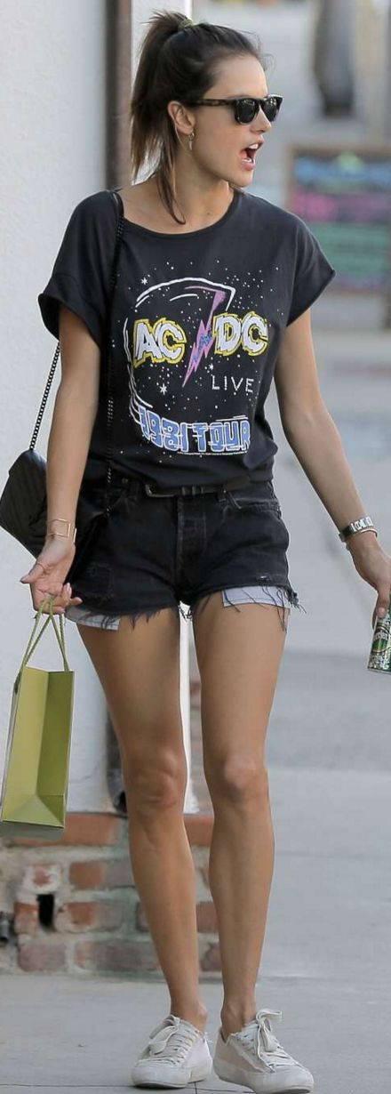 Alessandra Ambrosio's black print tee, quilted handbag, white sneakers, and cut out denim shorts
