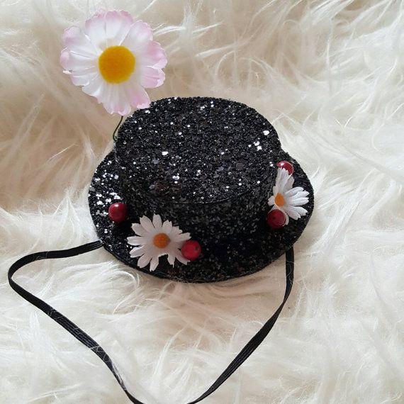 Mary Poppins Hat Headband Adorned with Daisys and berries..hat is in in a glittery black, a practically perfect replica, perfect for a Disney trip or Halloween costume. Size is 4 diameter × 2 tall..with additional height from larger Daisy on top of the hat 2  Glitter does NOT shed..hat is perfect for adults or children.