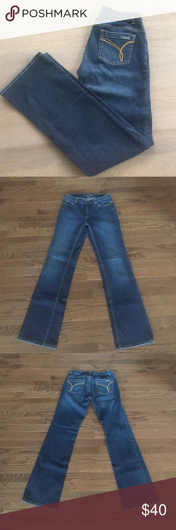 """Michael Kors stretch boot cut jeans MK medium dark wash denim stretch boot cut jeans. Mustard yellow embroidery on back pockets with """"Michael Kors"""" logo. 98 / 2 cotton / spandex Michael Kors Jeans Boot Cut"""