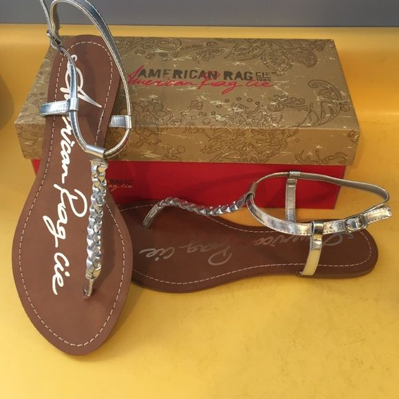 ON HOLD  American Rag Sandals 8.5 Silver T strap braided American Rag sandals. New in box size 8.5M. American Rag Shoes Sandals