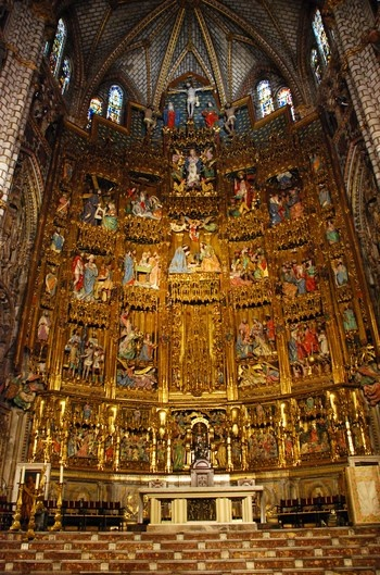 Toledo Cathedral (in Spain) built from 1226 to 1493, the long process is reflected in Toledo Cathedral's variety of styles. This is a picture of the Capilla Mayor, with a huge altarpiece of gilded and painted larchwood (1497-1504) stretching clear to the ceiling. A magnificent example of Gothic art, it is overflowing with intricate detail and summarizes the entire New Testament with life-sized figures, culminating in a Calvary scene at the top.  I would love to see this church