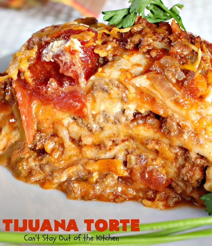 Tijuana Torte uses ground beef with stewed tomatoes, diced green chilies, taco seasoning--layered with flour tortillas, cheddar cheese, and sour cream. It's terrific for company dinners or Cinco De Mayo.