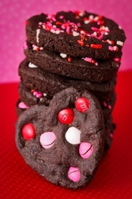 ~` chocolate heart cookies made using my favorite chocolate cookie recipe .  the heart shape comes from baking them in a whoopie pie pan! `~