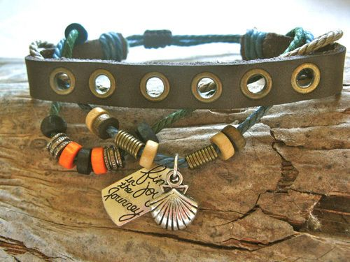 "Camino bracelet ft scallop shell. A lovely gift of symbolic jewellery. This lovely earthy leather-and-cord bracelet ~ find joy, features a row of wooden and metal beads with a metal scallop shell charm (as seen on Spain's Camino) and a little plaque that reads ""find joy in the journey""."