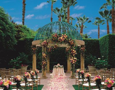 If you plan to get married under an outdoor arch, flowers such as these at The Ritz-Carlton, Marina del Rey can be color-coordinated with altar linens and garden path florals to create a stunning visual impression