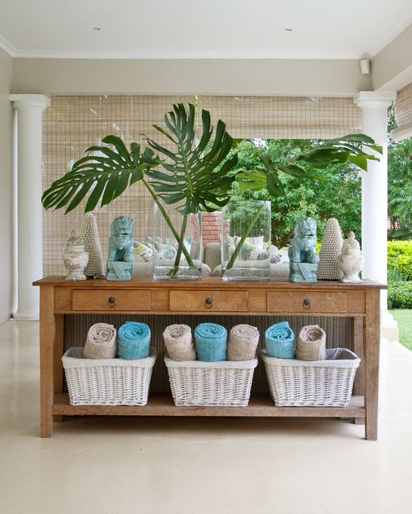console table with baskets for towels in summer and blankets in winter. Drawers are useful for sunblock, mosquito spray, matches etc
