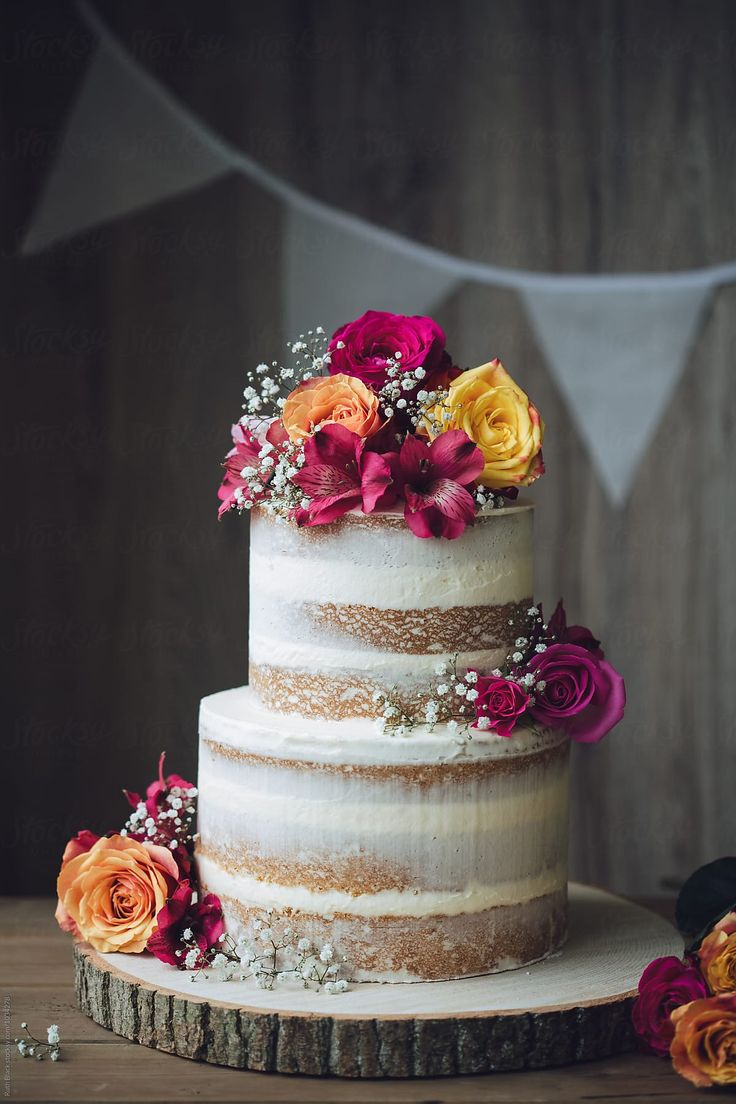 Wedding cake decorated with fresh flowers by Ruth Black