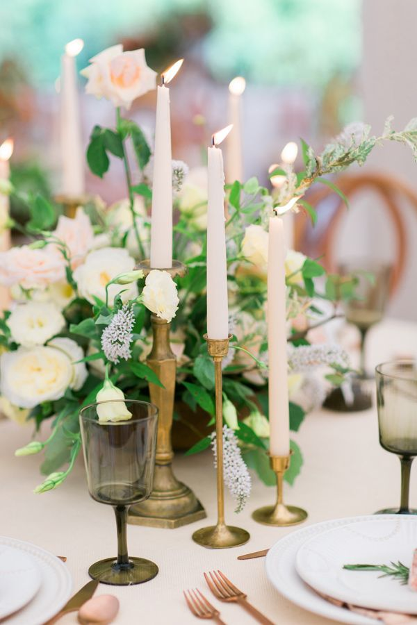 candlestick centerpieces - photo by Kivalo Photography http://ruffledblog.com/herbes-de-provence-wedding-inspiration