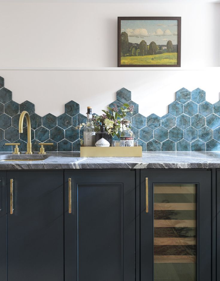 Blue Tones In The Hexagon Backsplash Above The Wet Bar Dark Teal Cabinet Color Paired With Brass Hardware Home Decor Dining Room Decor Decorating On A Budget