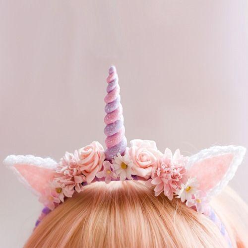 Cute, fairy kei: Pink and purple unicorn headdress with flowers.