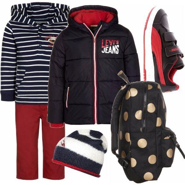 Blu-rosso-bianco abbinati ad oltranza, la tuta a righe, il giubbotto imbottito, la scarpa e il berretto di lana, anch'esso a righe l'unica eccezione lo zaino a pois grandi.
