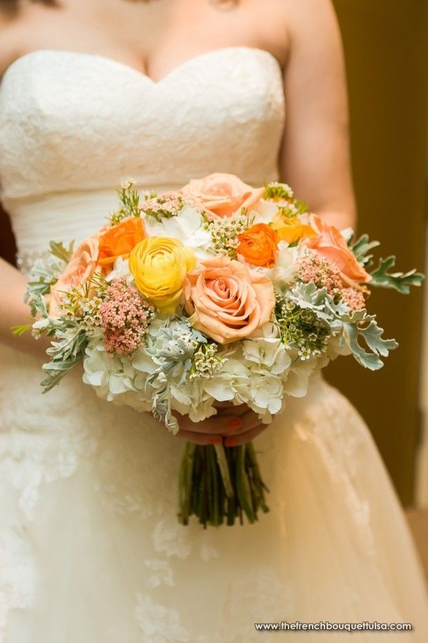 This is pretty close to what my wedding bouquet looked like but with fewer fillers and a few more roses.  Bridesmaids had BRIGHT rose bouquets to compliment my softer colors.  <3.