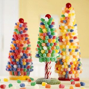 Visions of Gumdrop Trees    Decorative trees made from Styrofoam cones and multicolored gumdrops are a fun family project during the holidays. Display them on a side table, as shown, or in a gingerbread house scene.