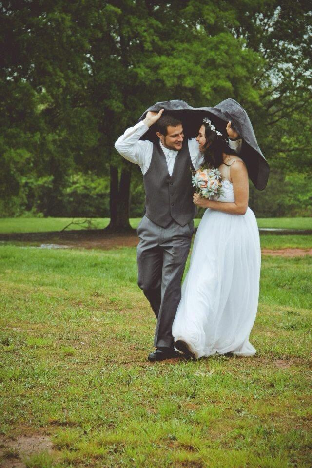 Ditch the umbrellas for his jacket! #love #rainyday #weddingbelle - For more ideas and inspiration like this, check out our website at www.theweddingbelle.net