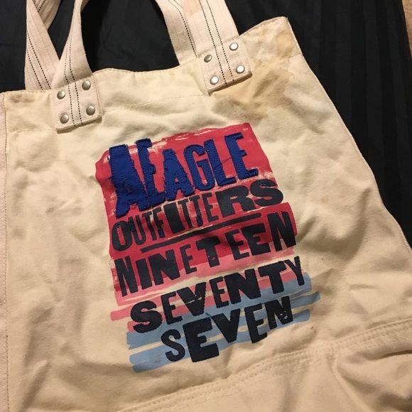 "large tote bag from American Eagle American Eagle bag. Medium size stain from coffee on upper bag and handle. Still in good condition. Bag states ""AEagle Outfitters-Nineteen seventy seven."" American Eagle Outfitters Bags Totes"
