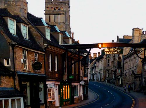 "Stamford, Lincolnshire; about 100 miles north of London off the A1 to York. This frightfully gorgeous Dickensian town was left mainly untouched from the architectural blights of the Industrial Revolution; and remains a village with ""street after..."
