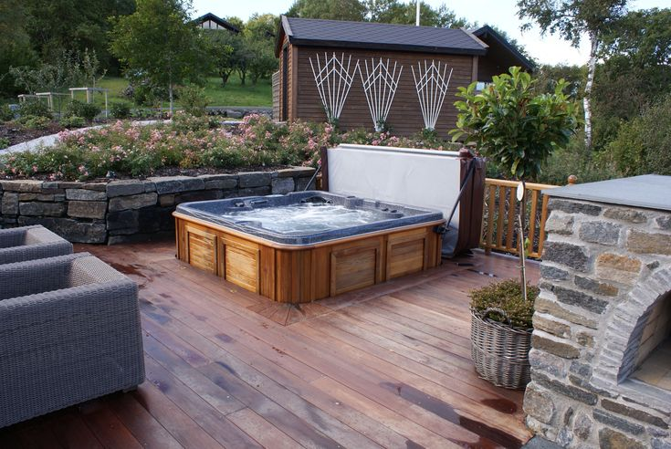 A hot tub sunken into the deck. Looks great!