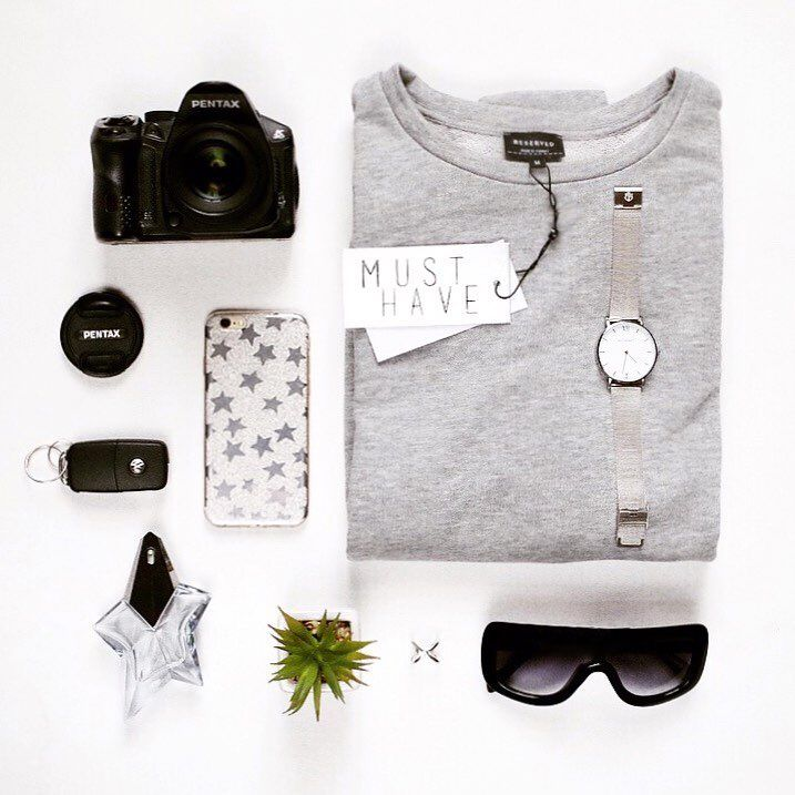 @viovisions #flatlay #photography #fashion #iphone #dslrcamera #dslr #watch #musthave #musthaves  #Pentax #sunglasses #sweatshirt #grey #black