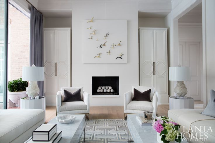 In this serene space off the loggia, quartz lamps by Kathryn McCoy sit pretty on marble tables by Grey Furniture, while soft Donghia-clad seating by Björk Studio rests on a hide rug by Kyle Bunting.