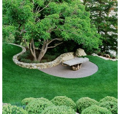I really like the idea of a disappearing rock wall. the sweep from high to low has great potential in the back yard.