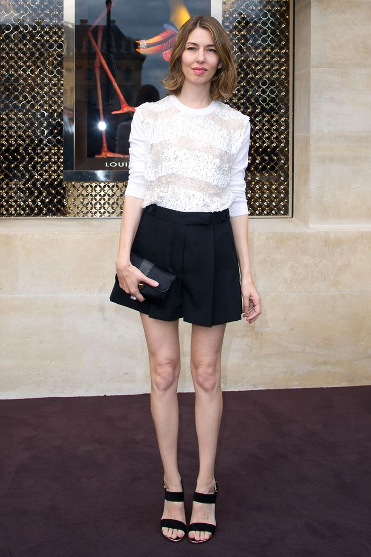 nice combi -white blouse and wide shorts; cullotes for me. See the shoe choice too. Simple and chic