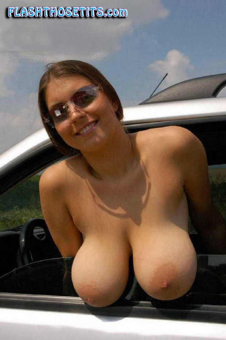 naked girl next to car