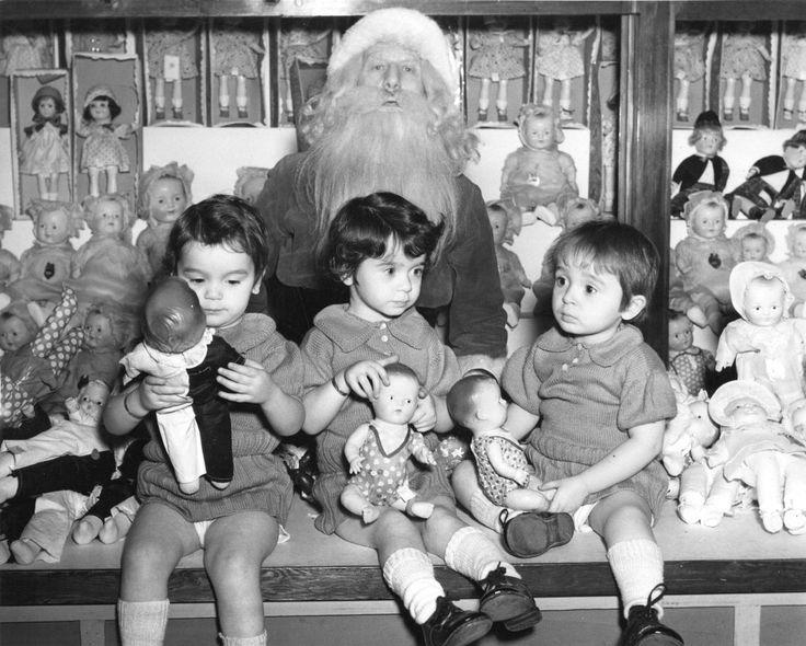 The Case triplets visit Santa, 1939. (Photo via Vancouver Archives)