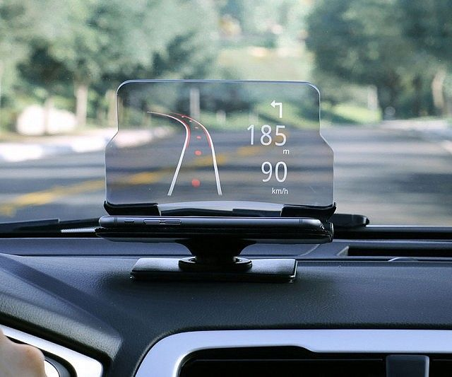 Improve your driving experience by ushering your vehicle into the digital age with the smartphone heads up display system. This revolutionary accessory fits discreetly on the dashboard and works with almost any smartphone to provide real time driving information.