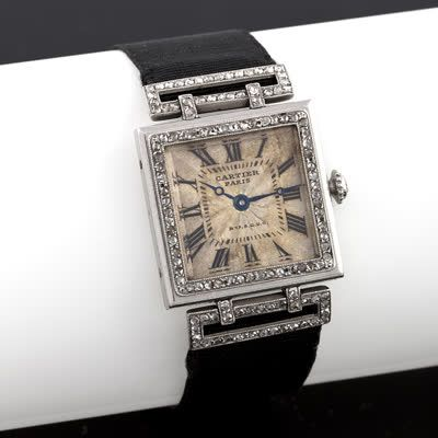 Cartier Art Deco Diamond and Platinum Wrist Watch, An exceptional French Art Deco platinum and 18 karat gold watch with diamonds by Cartier. The watch has 117 rose-cut diamonds. The deployment clasp is 18 karat gold set with diamonds on a silk strap. circa 1918-20.