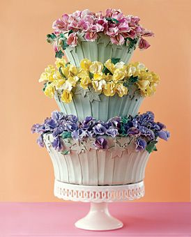 Unique Wedding Cake: Baskets of blooming sweet peas and ivy fill a trio of porcelain-like fondant planters.