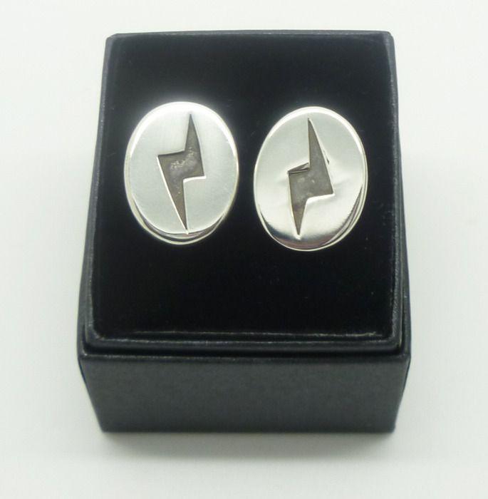 Bowie's Lightening Bolt Cufflinks - Sterling Silver  http://www.hilaryandjune.com/product/david-bowie-s-lightening-bolt-cufflinks-sterling-silver