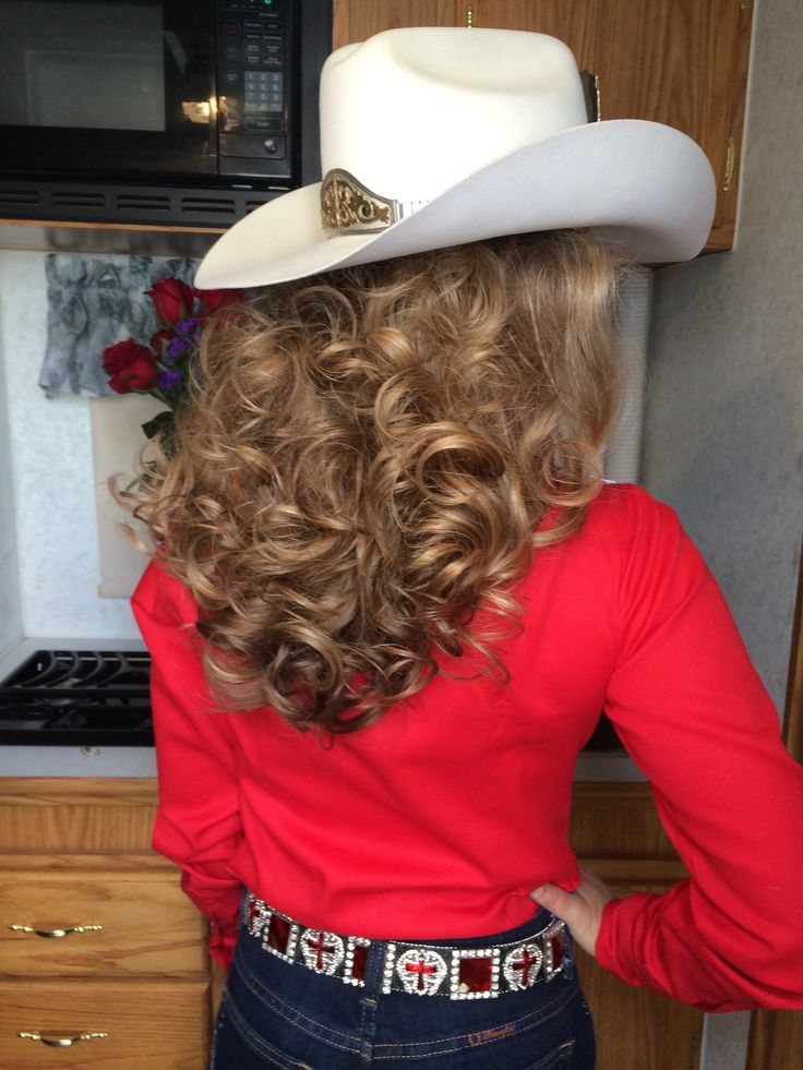 """put my in a pony tail, rolled it with hot rollers, sprayed it with """"Big Sexy Hair, Spray and Play Harder"""" hairspray, grabbed a blanket, stuck my head in the freezer for ten minutes, left it in til the rodeo, took all the rollers out, cut the pony tail, and put my hat on. This isn't me, but it looks a lot like how my hair came out my first couple years of being a rodeo queen."""