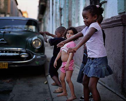 Dancing in the streets. I love it when children dance!