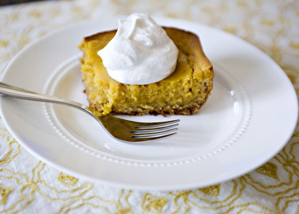 Pumpkin Gooey Butter Cake recipe - This recipe became a staple at my Thanksgiving table completely by accident.  It is a classic Paula Deen recipe and I made it one day one a whim because it just looked so good.  I watched Paula make it on her show and it looked so easy and so, well, Paula. #cake #dessert #holiday #pumpkin
