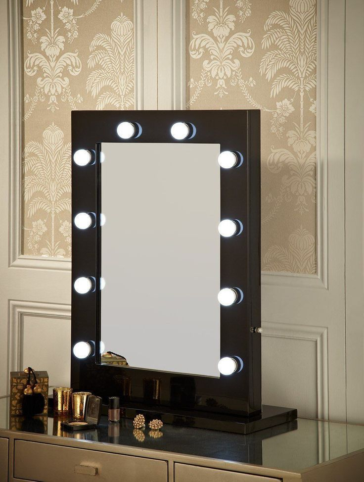 Hollywood Mirror In Black Gloss| Makeup Mirror with Lights | Dressing Table Mirror with Lights | Vanity Mirror with Lights | Illuminated Makeup Mirror | Holllywood Mirror UK | Light Up Makeup Mirror | Hollywood Mirrors | Mirror Size 80 X 60cm | This illuminated Hollywood mirror is a fabulous statement mirror. With 10 led light bulbs & an optional white high glossy stand for when used in the freestanding portrait position on your dressing table. #hollywoodmirror #makeupmirror #vanitymirror…
