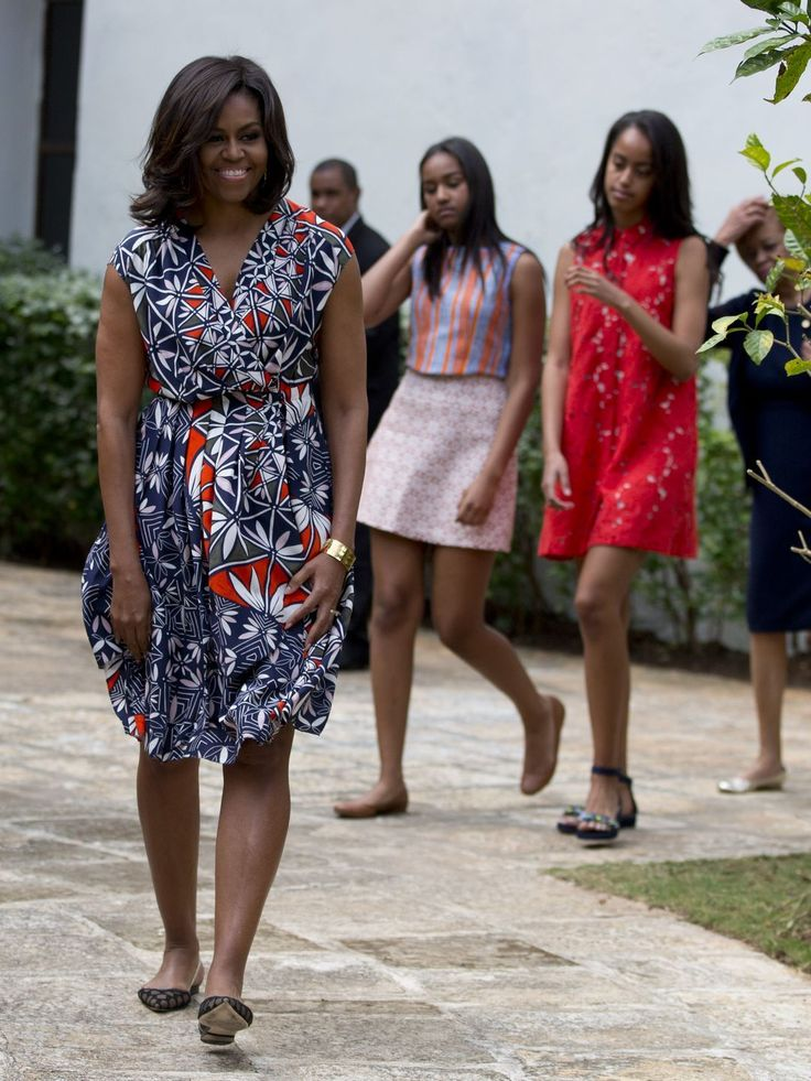 "U.S. First Lady Michelle Obama, is accompanied by her daughters Sasha, and Malia, as she arrived to dedicate a gift of two magnolia trees and a bench, at a small park beside Ruben Martinez Villena public library in Plaza de las Armas, Old Havana, Cuba, Tuesday, March 22, 2016. The bench bears the inscription in English and Spanish ""A gift to the people of Cuba from Mrs. Michelle Obama, first lady of the U.S., March 2016."