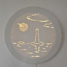 Tableau lumineux rond 'hublot sur phare' à led