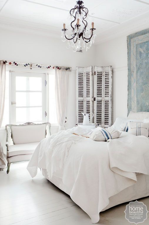 Achieve understated sophistication with crisp white bedding. An old door found at a secondhand store makes a beautiful corner feature.