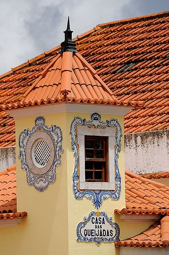 Sintra, Portugal...beautiful red tile rooftops and colorful ceramic tile accents.