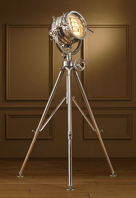 I love this Floor Lamp; Restoration Hardware introduced it on their product line in 2010;  reproduction of a 19th-century British marine light used for transmitting Morse code!  The Royal Master Sealight Floor Lamp (Restoration Hardware) crafted from solid cast aluminum and features a machine-turned gear mechanism used to position the light head up or down. The Royal Master Sealight is designed with a height-adjustable, telescopic tripod base