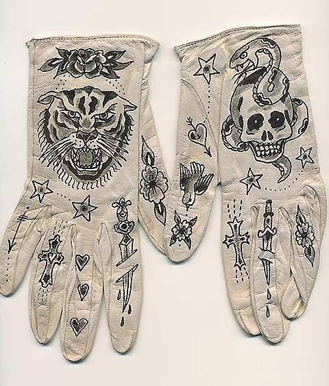 Chicago artist Ellen Greene makes leather gloves with 'tattoos' on them, that is she paints old-school sailor tattoos onto them. They're pretty cool.